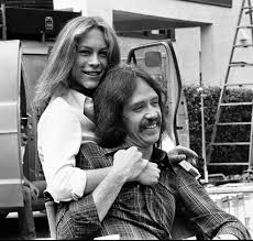 jamie lee curtis and writer director john carpenter share a moment