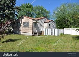 small bungalow home tan siding stock photo 122077129 shutterstock