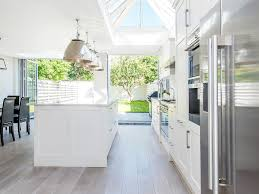 Open Plan Flooring by Oversized Pendants Marble Worktop Kitchen Isllarge Folding Glass