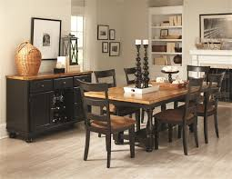 two tone dining table set 5 piece dining table set in rustic amber black two tone finish by