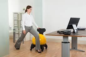 woman exercising at desk pilates ball adjule desk