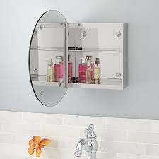 showcase series stainless steel medicine cabinet with round mirror