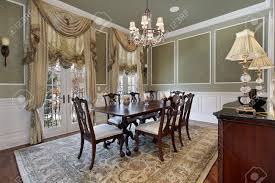 dining room in luxury home with french doors stock photo picture