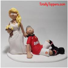 wedding cake toppers and groom a dragging a groom manchester united football wedding cake