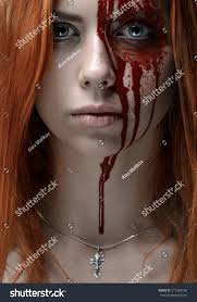 red hair bloody face chain stock photo 217368148 shutterstock