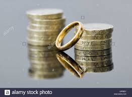 wedding money money with wedding ring showing concepts of pre nuptial agreement