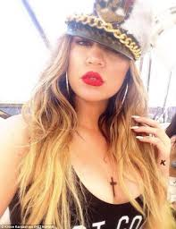 khloe kardashian poses in plunging swimsuit with fake tattoos as