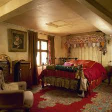 cream yellow paint moroccan themed bedroom with red bedding on
