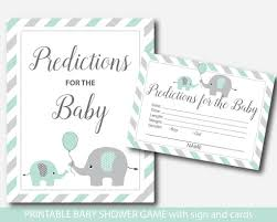 mint baby shower prediction with cards and sign mint green