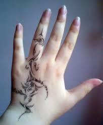 wedding ring finger and smallish tattoos