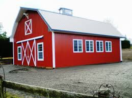 small red interior of a gambrel pole barn as a home with white