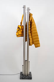italian stainless steel and marble coat rack with integrated light