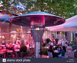 gas heaters for patios gas patio heater outside restaurant london uk stock photo