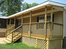 mobile home front porch with wood deck gabled roof handrail with