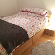 habitat adams solid oak double bed with storage with ikea sultan