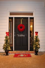 elegant outdoor christmas decor with twin potted trees plus