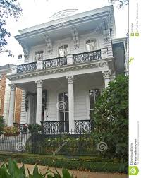 flat roofed italianate home with columned porch stock photo