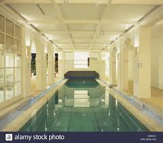 large indoor swimming pool in modern spanish villa stock photo