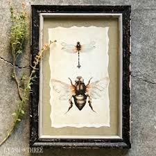 distressed tattered wood frame with bumblebee dragonfly vintage