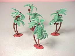 set of 4 plastic palm trees