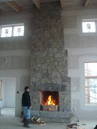 smooth stucco fireplace cobblestone reclaimed wood mantle stone