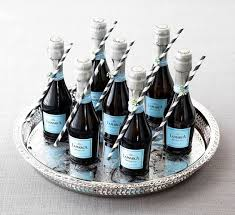 wine bottle favors where to find mini chagne bottle wedding favors woman getting