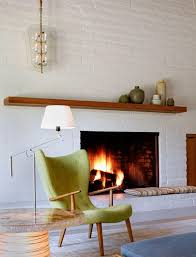 painted brick with wood mantle portola valley midcentury living room san francisco the office of charles de lisle