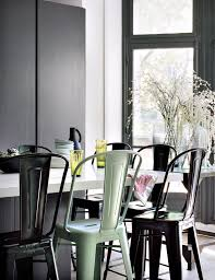 Tolix Dining Chairs Absolutely Gorgeous Dark Wall Apartment Of Barbara Boccara