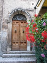 italian doors with red flowers when one door closes another