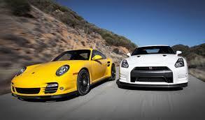 nissan sports car black nissan gt r black edition vs porsche 911 turbo s head 2 head