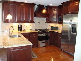 kitchen cabinet luxury black kitchen with tier island and light