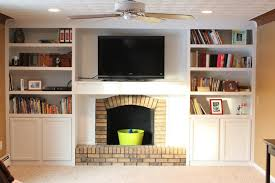 furniture brick fireplace and tv stand with built in book cabinet