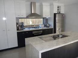 stainless steel backsplashes for kitchens granite countertop kitchen cabinets 10x10 cost starline