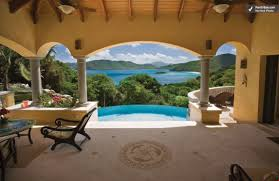 photos of luxury caribbean villa on st john near a beach villa