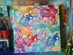 pop art painting of pop guns stencil art spray paints colors