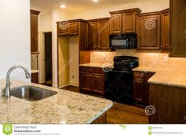 stainless steel sink and black appliances stock photo image