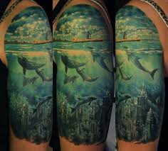 tattoos inked magazine whales swim above the lost