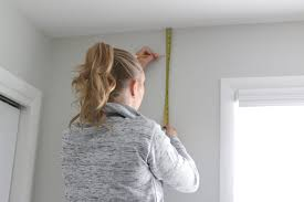 Hanging Curtains From The Ceiling How To Hang Curtains To Make Your Windows Look Bigger Easy Diy