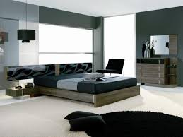 large modern bedroom design with dark gray wall interior color
