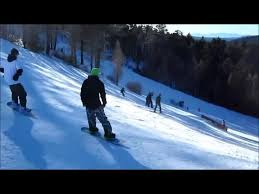 trips over rail while snowboarding jukin media