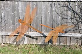 unique arts dragonfly garden stakes in string lights metal garden