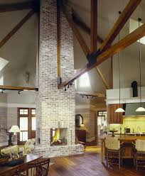 brick fireplace living room farmhouse with central fireplace large