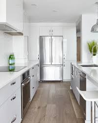 white contemporary kitchen cabinets gloss glossy white lacquered cabinets framing refrigerator