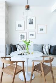 black and white photo gallery over dining bench transitional