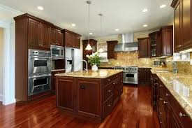 what color floor with cherry cabinets dark floor cherry cabinets with tan or brown granite dark wooden
