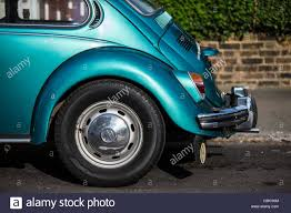volkswagen beetle green metallic green volkswagen beetle classic shape stock photo