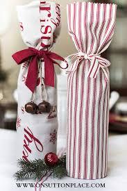 gift wrapping wine bottles hostess gift ideas wrap a wine bottle in a festive tea towel