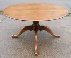 large round oak pedestal dining table to seat eight