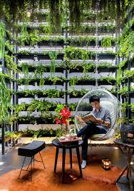 the vertical garden in this house reconnects the residents with