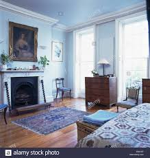 Pale Blue Rug Large Picture Above Marble Fireplace In Pale Blue Bedroom With